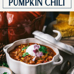 Side shot of turkey pumpkin chili in a bowl on a table with text title box at top