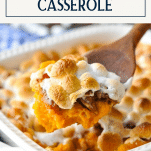 Spoon serving sweet potato casserole with marshmallows and pecans and text title box at top